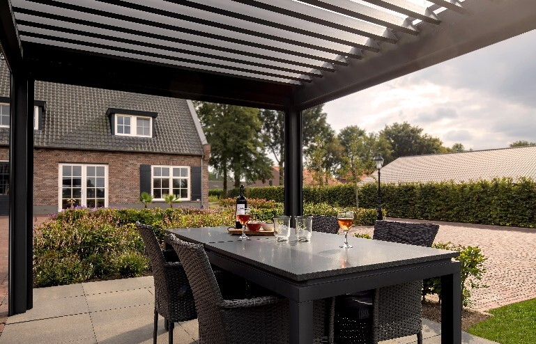 Bioclimatic pergola over dining table